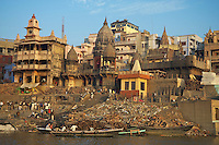 Early morning activities, ceremonies, bathing ritual and life at the Ganges River in Varanasi India
