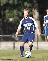 University of Rhode Island (URI) midfielder Brett Uttley (14) brings the ball forward. Boston College defeated University of Rhode Island, 4-2, at Newton Campus Field, September 25, 2012.