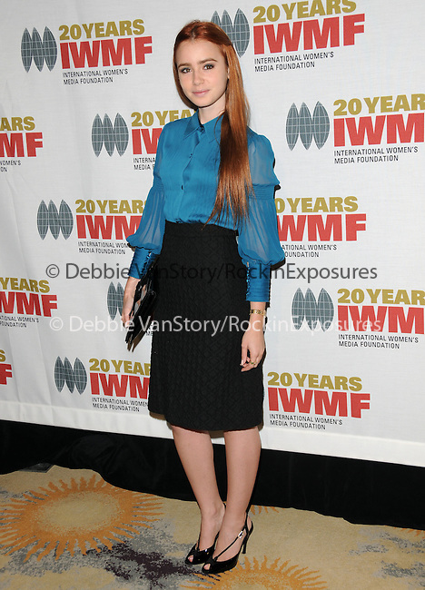 Lily Collins at The 2009 Courage in Journalism Awards held at The Beverly Hills Hotel in Beverly Hills, California on October 28,2009                                                                   Copyright 2009 DVS / RockinExposures