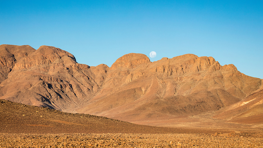 The Moon Rises Above The Landscape On The Road To Sossusvlei.