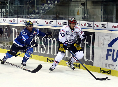 28th September 2017, Saturn Arena, Ingolstadt, Germany; German Hockey League,  ERC Ingolstadt versus Eisbaren Berlin;  Patrick MCNEILL (Ingolstadt/CAN) chases down Jens BAXMANN (Berlin)