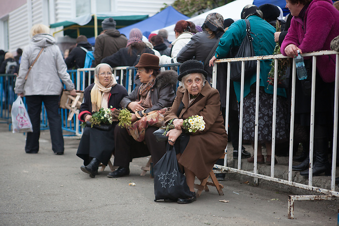 Pilgrims stay inline waiting to worship the relics of Saint Parascheva in Iasi, October 12, 2013, near the Metropolitan Cathedral. Average time of waiting in line was 15 hours. During the 5 days of pilgrimage, over 900 people required medical treatment and a 55-year-old woman died in hospital after he spent a night in the queue.