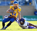 BROOKINGS, SD - OCTOBER 24:  Brady Mengerelli #44 from South Dakota State tries to slip the arm tackle of Rickey Neal #26 from University of Northern Iowa in the second quarter of their game Saturday afternoon at Coughlin Alumni Stadium in Brookings. (Photo by Dave Eggen/Inertia)