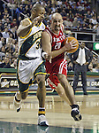 Houston Rockets'  Jon Barry (R) is called for charging foul against Seattle SuperSonics' Ray Allen (L) during the first period of their game at Key Arena in Seattle, Washington Monday, 11 April 2005.  Jim Bryant Photo. ©2010. All Rights Reserved.