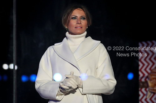 First lady Melania Trump listens as President Donald Trump speaks during the 2018 National Christmas Tree Lighting Ceremony at the Ellipse near the White House on November 28, 2018 in Washington, DC.<br /> Credit: Oliver Contreras / Pool via CNP