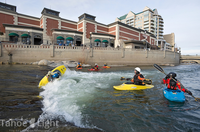World champion junior kayaker Jason Craig of Reno, NV, cartwheeling in hole, practices as other local kayakers look on at the whitewater park on the Truckee River in downtown Reno, NV