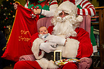 TORRINGTON, CT. 20 December 2019-122019BS13 - Santa holds one week old baby Austin Middlebrook, of Torrington, during a visit by Santa at the FISH of Northwestern Connecticut Homeless Shelter in Torrington on Friday. Bill Shettle Republican-American