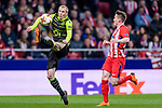 Jeremy Mathieu of Sporting CP (L) fights for the ball with Kevin Gameiro of Atletico de Madrid (R) during the UEFA Europa League quarter final leg one match between Atletico Madrid and Sporting CP at Wanda Metropolitano on April 5, 2018 in Madrid, Spain. Photo by Diego Souto / Power Sport Images