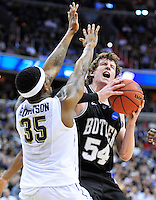 Matt Howard of the Bulldogs is fouled by Panthers' Nasim Robinson while going to the basket. Butler upset no.1 seed Pittsburgh 71-70 during the 3rd round of the NCAA Tournament at the Verizon Center in Washington, D.C on Saturday, March 19, 2011. Alan P. Santos/DC Sports Box