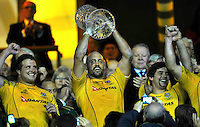 Twickenham, England. Nathan Sharpe of Australia lifts the Cook Cup at the QBE international match between England and Australia for the Cook Cup at Twickenham Stadium on November 10, 2012 in Twickenham, England