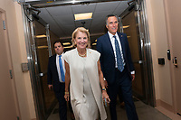 United States Senator Cindy Hyde-Smith (Republican of Mississippi) and United States Senator Mitt Romney (Republican of Utah) make their way to the Senate Floor on Capitol Hill in Washington D.C., U.S. on July 31, 2019. Photo Credit: Stefani Reynolds/CNP/AdMedia