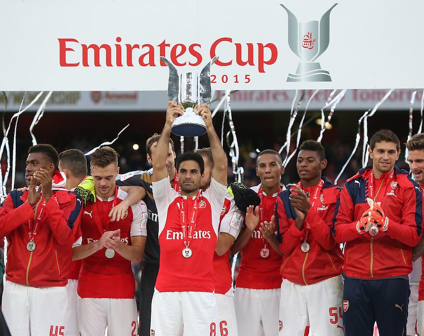 Arsenal's Mikel Arteta with Trophy<br /> <br /> Photographer Kieran Galvin/CameraSport<br /> <br /> Football - Emirates Cup - Arsenal v Wolfsburg - Sunday 26th July 2015 - Emirates Stadium - London <br /> <br /> &copy; CameraSport - 43 Linden Ave. Countesthorpe. Leicester. England. LE8 5PG - Tel: +44 (0) 116 277 4147 - admin@camerasport.com - www.camerasport.com
