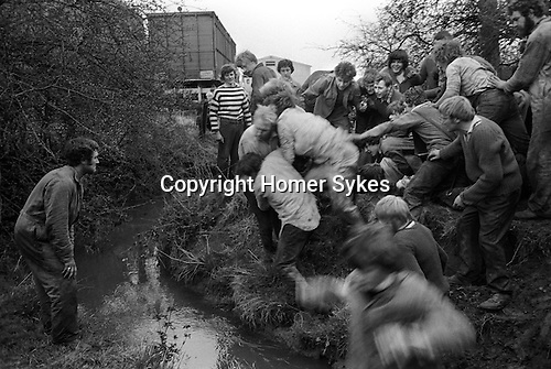 Bottle Kicking and Hare Pie Scrambling. Hallaton, Leicestershire 1973. Scoring a goal for Medbourne. Rodney Burns defending for Hallalton.