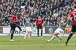 10.03.2018, HDI Arena, Hannover, GER, 1.FBL, Hannover 96 vs FC Augsburg<br /> <br /> im Bild<br /> Ihlas Bebou (Hannover 96 #13) mit Torschuss, Gojko Kacar (FC Augsburg #20) dazwischen, <br /> <br /> Foto &copy; nordphoto / Ewert