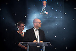 © Joel Goodman - 07973 332324 . 03/03/2016 . Manchester , UK . Fran Eccles-Bech and Paul O'halloran watch as Michael Hardacre , president of Manchester Law Society , speaks at the ceremony . The Manchester Legal Awards from the Midland Hotel . Photo credit : Joel Goodman
