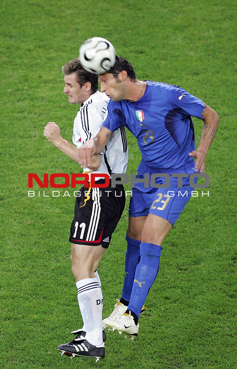 FIFA WM 2006 - Semi-finals / Halbfinale<br /> <br /> Play #61 (04-Jul) - Germany vs Italy.<br /> <br /> Miroslav Klose (l) from Germany and Marco Materazzi (r) from Italy fight for the ball during the match of the World Cup in Dortmund.<br /> <br /> Foto &copy; nordphoto