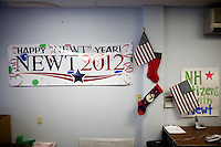 "A banner reading ""Happy Newt Year"" hangs next to American flags on the wall at the Newt Gingrich New Hampshire campaign headquarters in Manchester, New Hampshire, on Jan. 7, 2012. Gingrich is seeking the 2012 Republican presidential nomination."