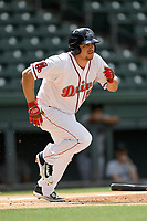Third baseman Everlouis Lozada (4) of the Greenville Drive runs out a batted ball in a game against the Augusta GreenJackets on Thursday, May 17, 2018, at Fluor Field at the West End in Greenville, South Carolina. Augusta won, 2-1. (Tom Priddy/Four Seam Images)