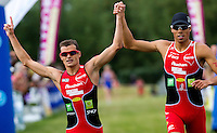 13 JUN 2010 - BEAUVAIS, FRA - Beauvais Triathlon Club team mates Frederic Belaubre (left) and Aurelien Raphael celebrate giving their team victory in the Beauvais round of the French Grand Prix triathlon series (PHOTO (C) NIGEL FARROW)