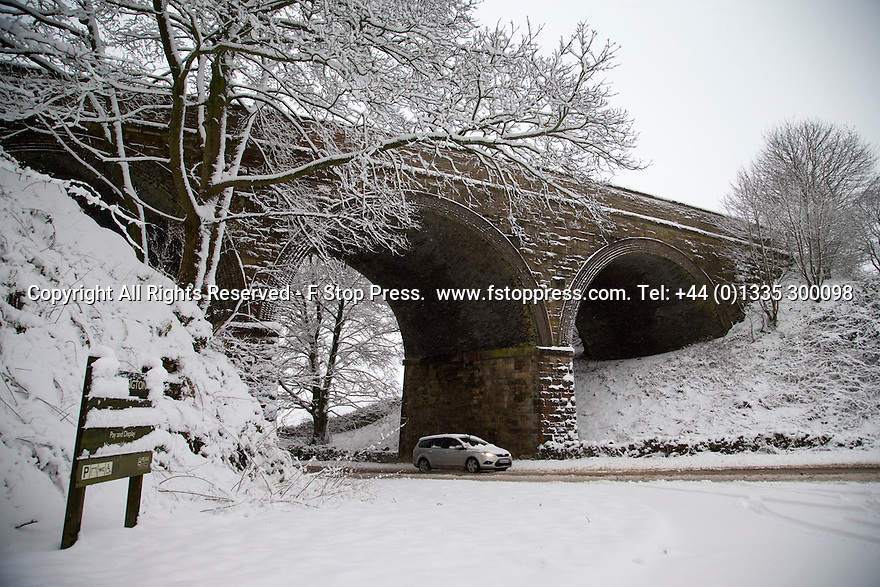 21/01/15<br /> <br /> A car makes its way under a bridge that carries the Tissington Trail near Hartington, Derbyshire.<br /> <br /> More than 20 schools in Derbyshire were closed today following overnight snowfall that continued into the morning across the Peak District.<br /> <br /> All Rights Reserved - F Stop Press.  www.fstoppress.com. Tel: +44 (0)1335 300098