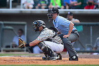 Birmingham Barons catcher Martin Medina (30) sets a target as home plate umpire Brennan Miller looks on during the game against the Tennessee Smokies at Regions Field on May 3, 2015 in Birmingham, Alabama.  The Smokies defeated the Barons 3-0.  (Brian Westerholt/Four Seam Images)