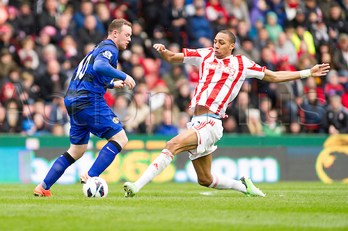 14.04.2013 Stoke, England.  Manchester United's Wayne Rooney and Stoke City's Steven N'Zonzi during the Premier League game between Stoke City and Manchester United from the Britannia Stadium.