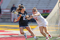 College Park, MD - April 27, 2019: John Hopkins Bluejays Miranda Ibello (8) is pushed by Maryland Terrapins defender Shelby Mercer (2) during the game between John Hopkins and Maryland at  Capital One Field at Maryland Stadium in College Park, MD.  (Photo by Elliott Brown/Media Images International)