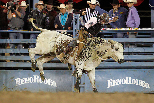 """23.06.2012. Reno, Nevdada, USA.  Dustin Elliott rides Mr. Clark during Bull Riding at the Reno Rodeo """"Wildest, Richest Rodeo in the West"""" at The Reno-Sparks Livestock Events Center in Reno, NV."""