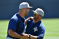 Outfielder Tim Tebow (15) of the Columbia Fireflies, left, laughs with manger Jose Leger during the team's first practice of the season on Sunday, April 2, 2017 at Spirit Communications Park in Columbia, South Carolina. (Tom Priddy/Four Seam Images)