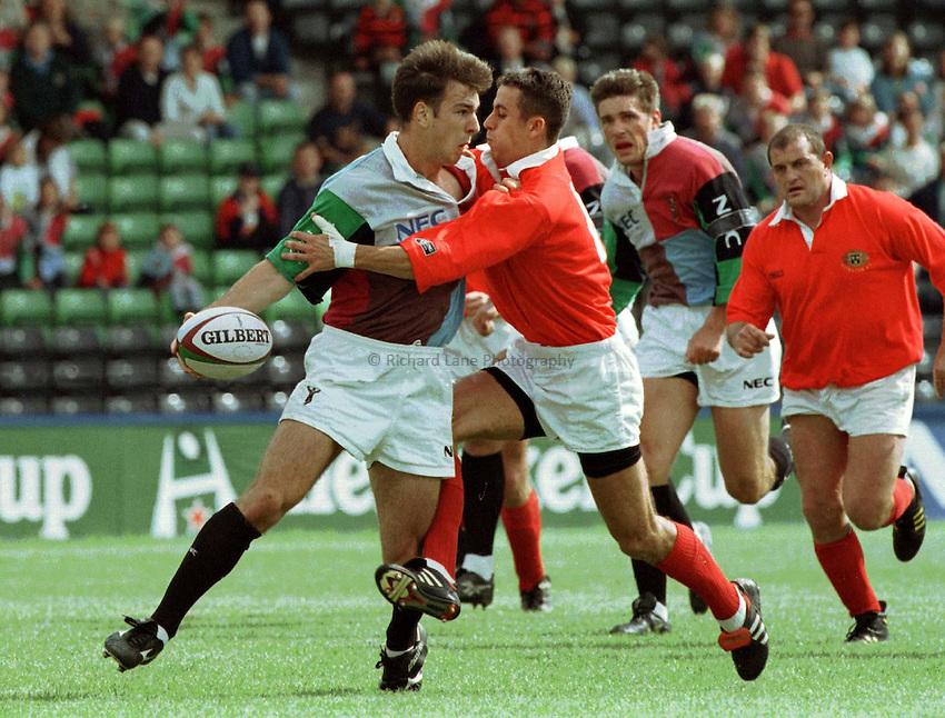 Photo : Ken Brown.7.9.97 Heineken Cup, Harlequins v Munster.Jamie Williams tries to kep the ball alive