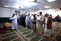 Roma, 2 Ottobre 2014<br /> Funerale islamico nella Moschea di Torpignattara di Muhammad Shahzad Khan, il giovane pakistano ucciso nel quartiere da un 17enne italiano che ha confessato l'omicidio.<br /> Gianaza, il rito islamico del funerale.<br /> Preghiera<br /> La salma  dopo il funerale verrà riportata in Pakistan.<br /> <br /> <br /> Rome, October 2, 2014 <br /> Islamic burial in the Mosque of Torpignattara of Muhammad Shahzad Khan, the young Pakistani killed in the district by a 17 year old Italian who has confessed the murder.<br /> The body will be returned after the funeral in Pakistan.