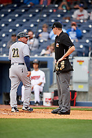 New Orleans Baby Cakes manager Arnie Beyeler (22) talks with home plate umpire Clint Vondrak during a game against the Nashville Sounds on May 1, 2017 at First Tennessee Park in Nashville, Tennessee.  Nashville defeated New Orleans 6-4.  (Mike Janes/Four Seam Images)