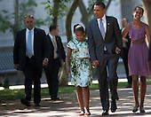 United States President Barack Obama (C) walks with his daughters Sasha (L) and Malia (R) through Lafayette Square from the White House to St. John's Protestant Episcopal Church July 17, 2011 in Washington, DC.  The First Family attended Sunday services..Credit: Brendan Smialowski / Pool via CNP