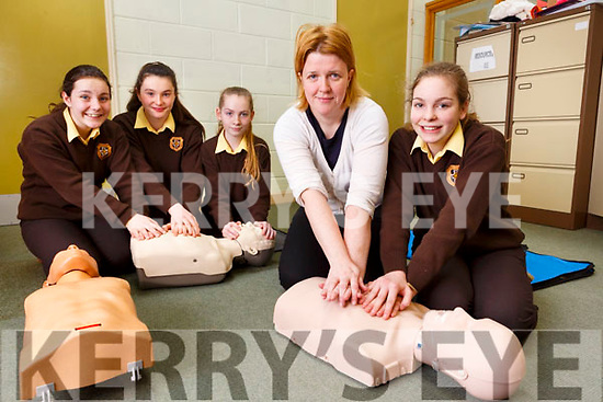 Majella Forde giving a demonstration on CPR to Katy Reidy and the students of the  Listowel Presentation school on Friday last.  Front, Majella Forde and Kath Reidy. Back L-r, Aivhin O'Neill, Muireann McElligott and Grainne Walsh.