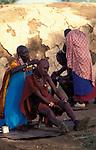 A Maasai moran has his head shaved by his mother as part of his initiation into manhood.<br /> Kajiado, Kenya.