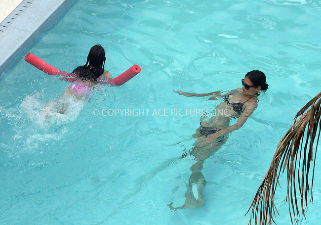 WWW.ACEPIXS.COM . . . . .  ....July 17 2011, Miami....Actress Katie Holmes and her daughter Suri Cruise went for a swim in their hotel pool on July 17 2011 in Miami beach....Please byline: NANCY RIVERA- ACEPIXS.COM.... *** ***..Ace Pictures, Inc:  ..Tel: 646 769 0430..e-mail: info@acepixs.com..web: http://www.acepixs.com