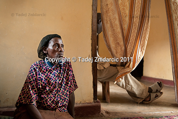 Rhoda Kukkiriza, mother-in-law of the late Sylvia Nalubowa in her house in Soweto village, Mityana District, Uganda. Sylvia Nalubowa died during childbirth in Mityana hospital in August 2009. She was giving birth to twins and one of the twins also died during childbirth.