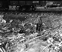 Homeless, this brother and sister search empty cans for morsels of food, and try to keep warm beside a small fire in the Seoul, Korea, railroad yards.  November 17, 1950.  Pfc. Fulton.  (Army)<br /> NARA FILE #:  111-SC-353947<br /> WAR & CONFLICT BOOK #:  1487