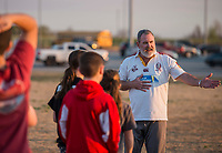 NWA Democrat-Gazette/ANTHONY REYES @NWATONYR<br /> Ben Harrell coaches kids Wednesday March 8, 2017 on rugby drills during practice at the Tyson Sports Complex in Springdale. Youth rugby teams have been put together through Springdale Parks and Recreation.