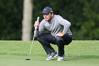 Francesco Molinari lines-up a putt on the 1st green - BMW Golf at Wentworth - Day 2 - 22/05/15 - MANDATORY CREDIT: Rob Newell/GPA/REX -