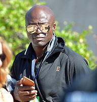 NOV 09 Seal Playing Tennis in Fort Lauderdale