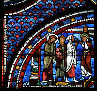 Martha and Mary mourn the death of their brother Lazarus, from the Life of Mary Magdalene stained glass window, 13th century, in the nave of Chartres cathedral, Eure-et-Loir, France. Chartres cathedral was built 1194-1250 and is a fine example of Gothic architecture. Most of its windows date from 1205-40 although a few earlier 12th century examples are also intact. It was declared a UNESCO World Heritage Site in 1979. Picture by Manuel Cohen