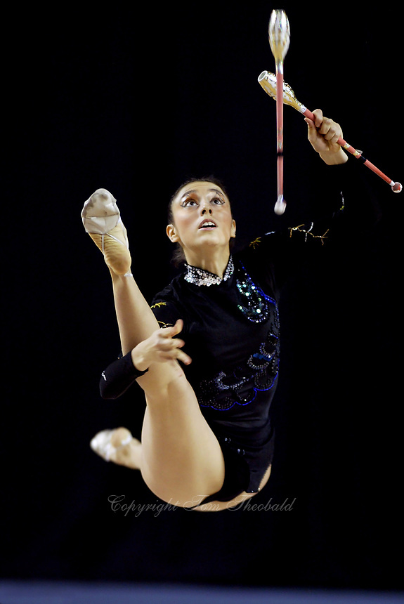 September 25, 2003; Budapest, Hungary; ANTONELLA YACOBELLI  of Argentina leaps to re-catch clubs at 2003 World Championships.