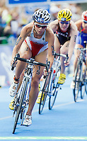 12 JUL 2014 - HAMBURG, GER - Kirsten Sweetland (CAN) from Canada leads the front pack during the bike at the elite women's 2014 ITU World Triathlon Series round in the Altstadt Quarter in Hamburg, Germany (PHOTO COPYRIGHT © 2014 NIGEL FARROW, ALL RIGHTS RESERVED)