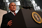 United States President George W. Bush makes remarks at the reopening of the National Museum of American History in Washington, DC on November 19, 2008. After the ceremony five people were sworn in as new citizens of the United States.  First lady Laura Bush attended with the President. <br /> Credit: Gary Fabiano / Pool via CNP