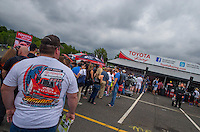 Jun 6, 2015; Englishtown, NJ, USA; Fans stand in long lines at an autograph session with the NHRA drivers on Team Toyota during qualifying for the Summernationals at Old Bridge Township Raceway Park. Mandatory Credit: Mark J. Rebilas-
