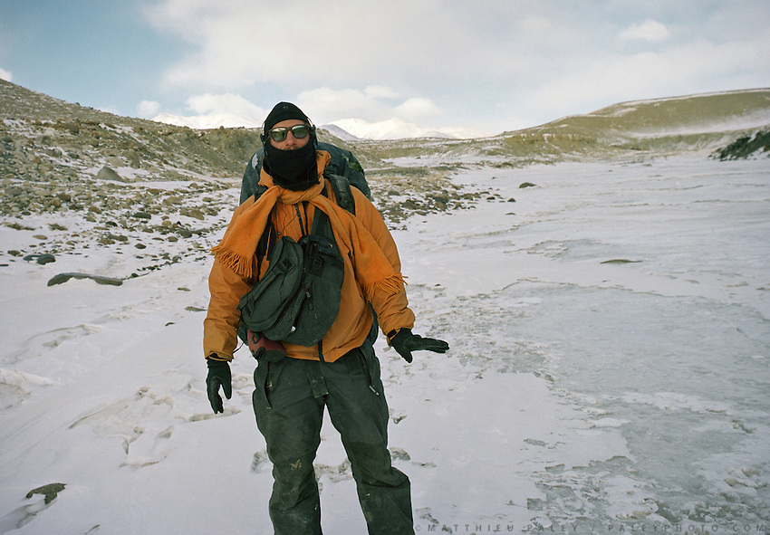 Photographer Matthieu Paley standing on the frozen Wakhan river, on the trek down from the Little Pamir mountains, the North East extremity of Afghanistan.