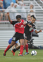 BOYDS, MARYLAND - July 21, 2012:  Lianne Sanderson (10) of DC United Women struggles for the ball against Victoria Johnson (26) of the Virginia Beach Piranhas during a W League Eastern Conference Championship semi final match at Maryland Soccerplex, in Boyds, Maryland on July 21. DC United Women won 3-0.