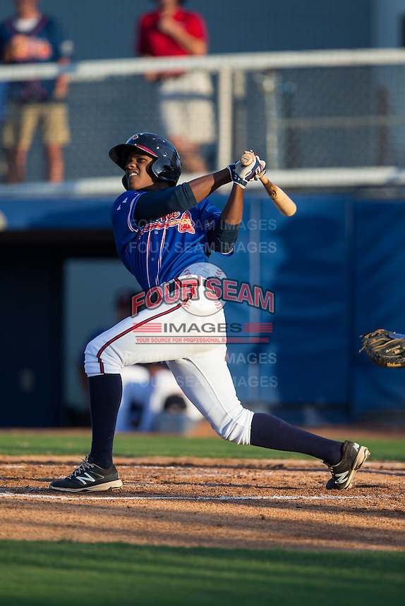 Kevin Josephina (2) of the Danville Braves follows through on his swing against the Kingsport Mets at American Legion Post 325 Field on July 9, 2016 in Danville, Virginia.  The Mets defeated the Braves 10-8.  (Brian Westerholt/Four Seam Images)
