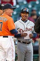 Detroit coach Rafael Belliard (17) smiles as he turns in the Tigers lineup before the MLB baseball game against the Houston Astros on May 3, 2013 at Minute Maid Park in Houston, Texas. Detroit defeated Houston 4-3. (Andrew Woolley/Four Seam Images).